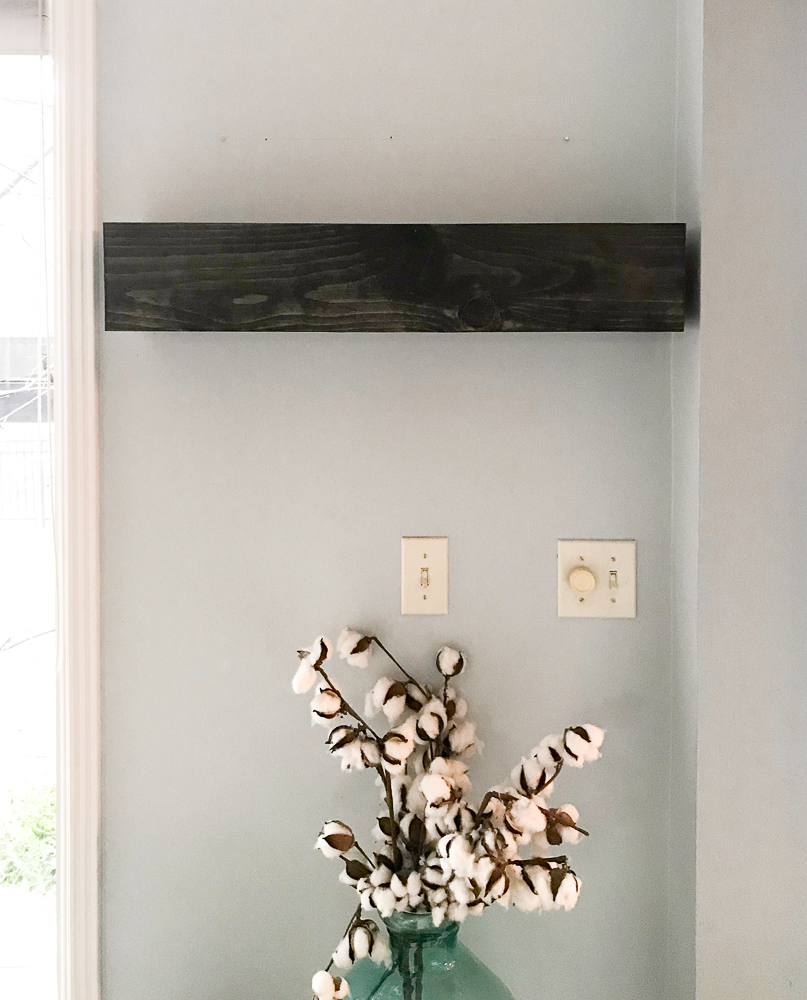 stained floating shelf