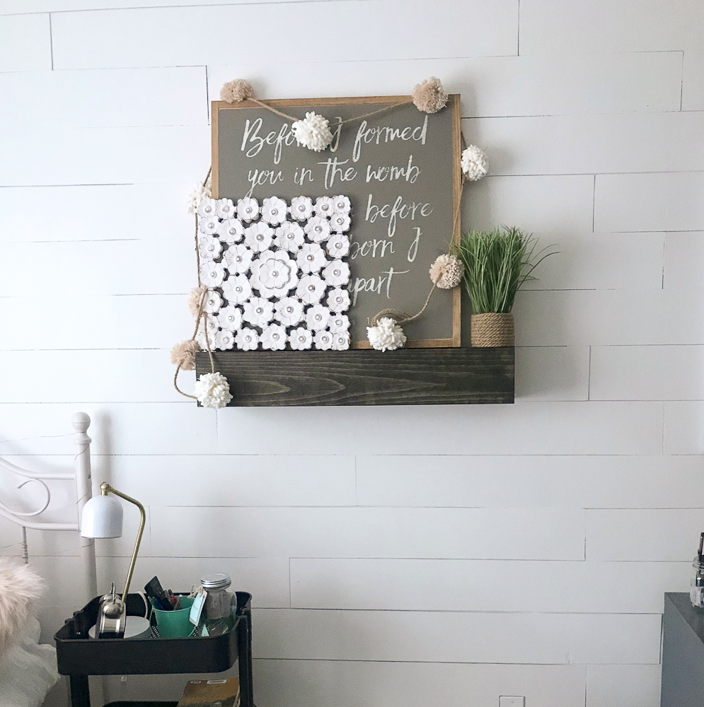 floating shelves styled with farmhouse decor on a wall of shiplap using underlayment