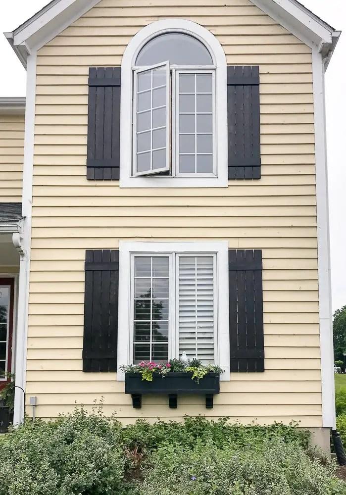 board and batten shutters add curb appeal