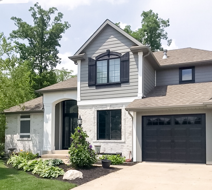 adding faux windows to garage doors adds curb appeal