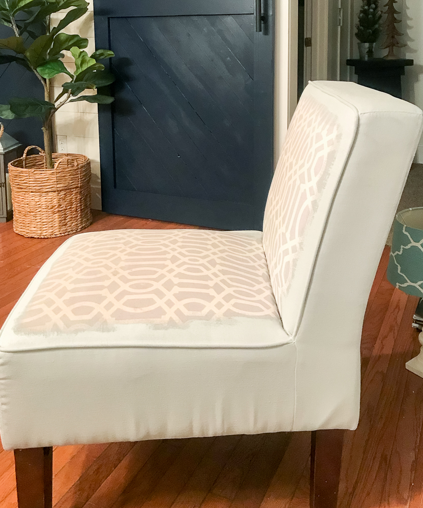 fabric chair with one coat of chalk paint halfway finished