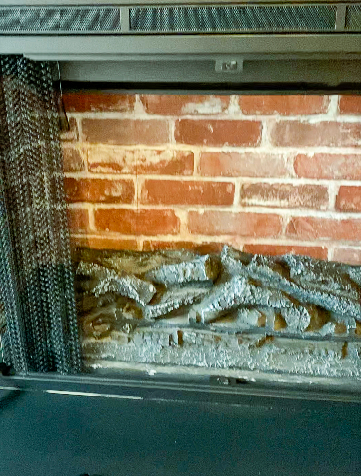 Red faux brick in electric fireplace