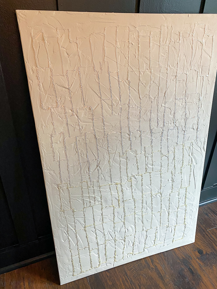 Canvas wall art with hot glue gun rectangles painted white
