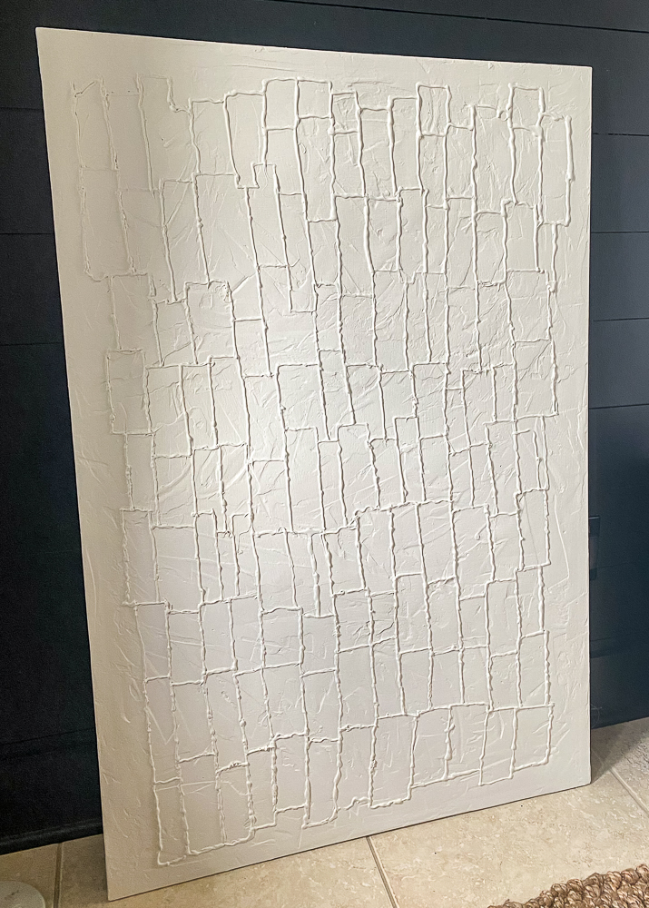 Canvas wall art with texture painted white