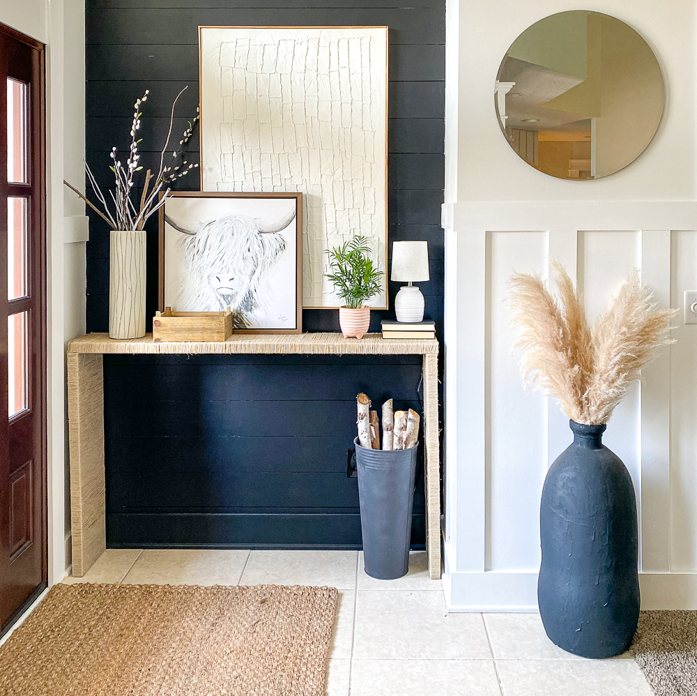 Beautiful foyer space with two canvas wall art pieces