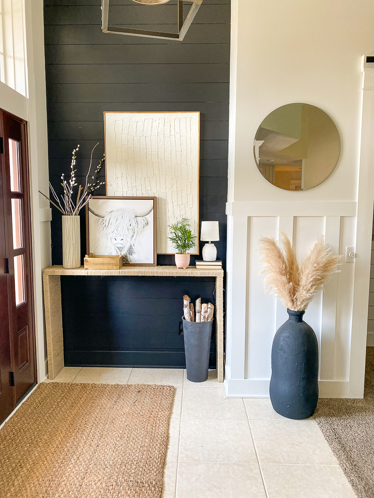 Foyer with console table and lots of decor on it