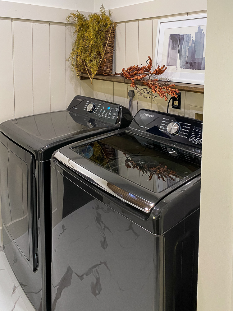 Laundry room with a black washer and dryer