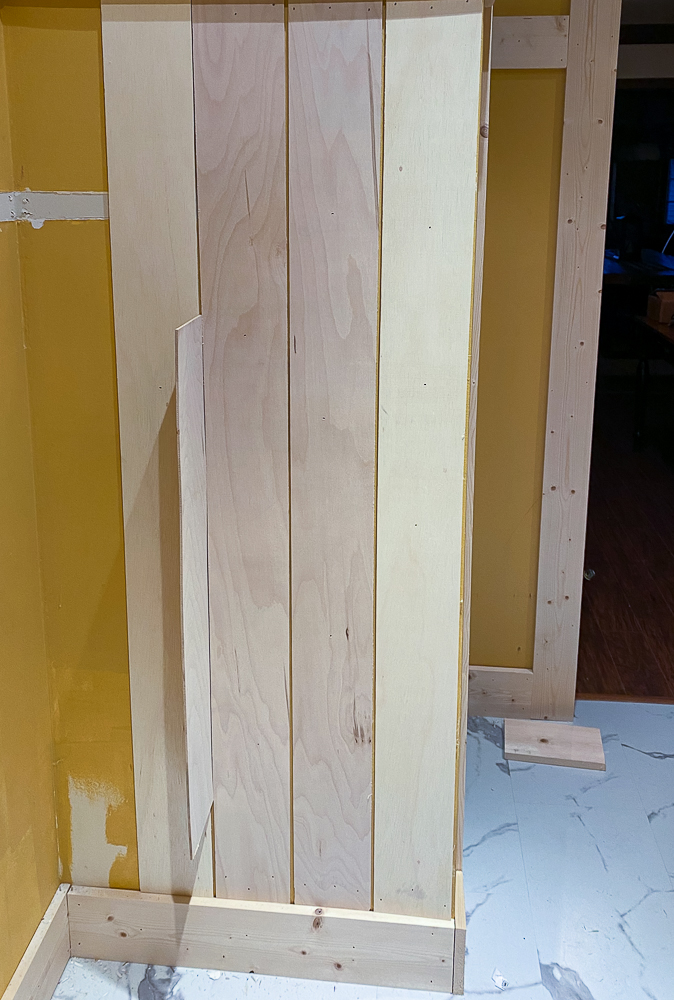 Vertical shiplap unpainted walls in a laundry room