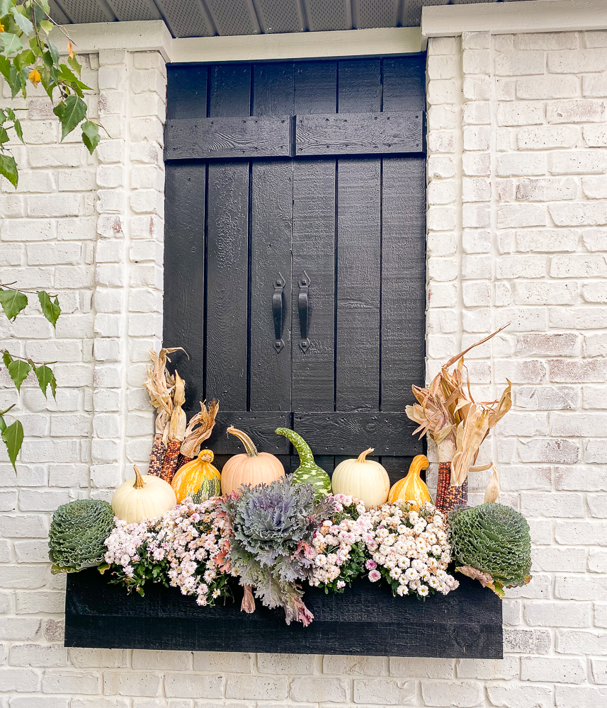 faux window with flower box and mums and pumpkins