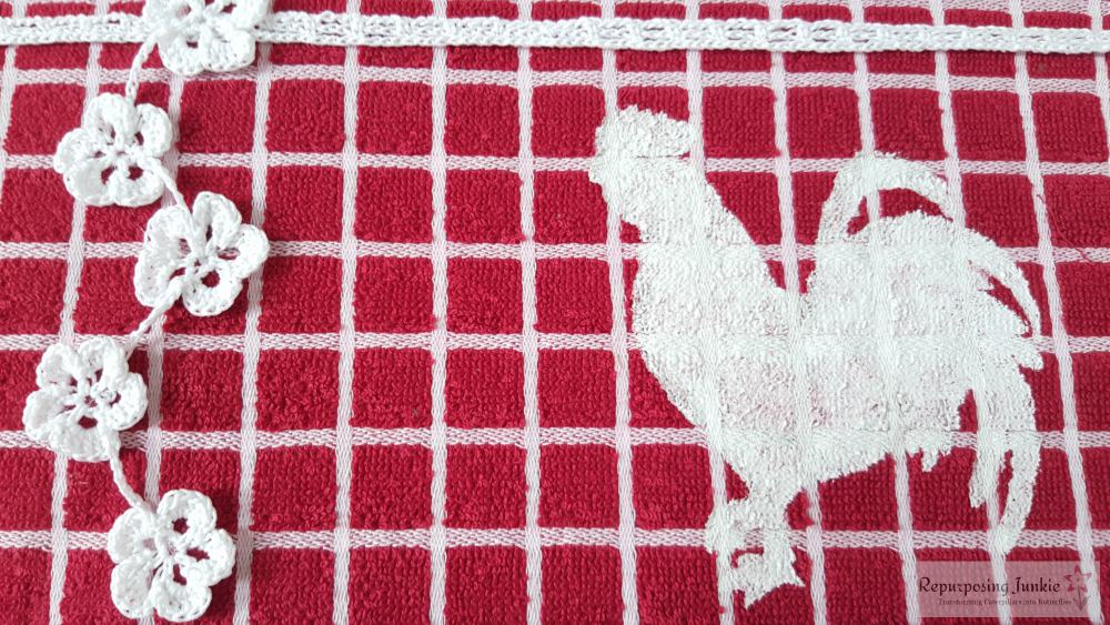 Repurposed Kitchen Towel into Wall Art: folk art, cow chicken, pig, rooster, red and white checkers, crocheted flower garland, DIY wall art