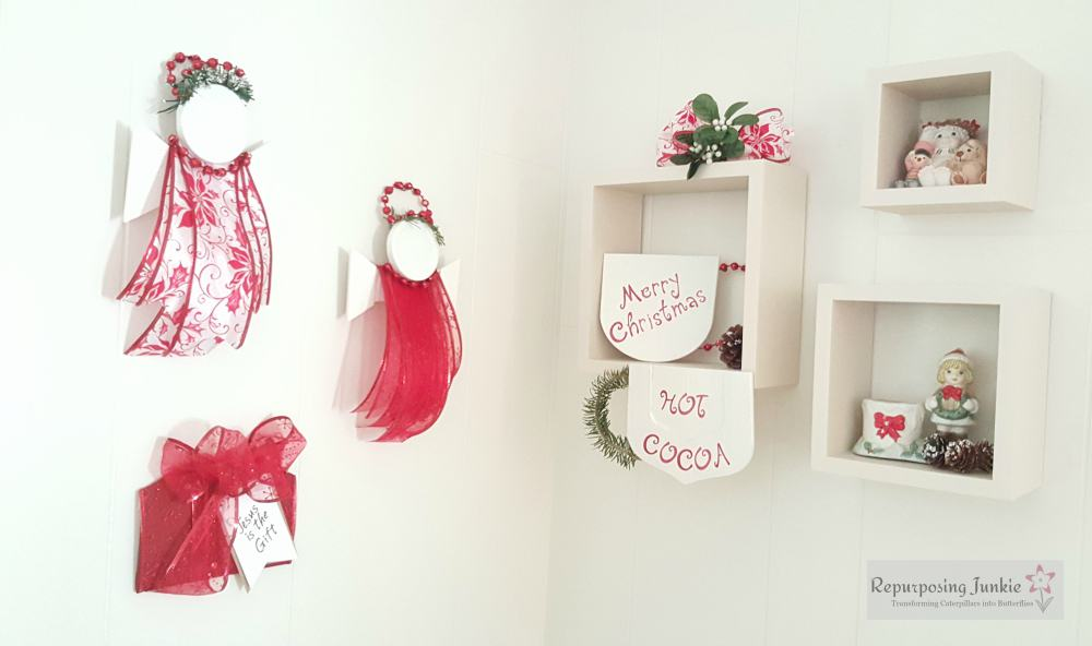 Repurposed ceiling fan blades into Red and White Christmas decor, angel, coffee, cocoa cups and present