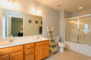 Master Bathroom with Double Bowl Vanity and Sliding Glass Door Shower