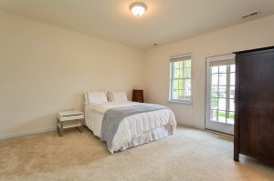 First Floor Master Bedroom with Direct Access to Private Patio