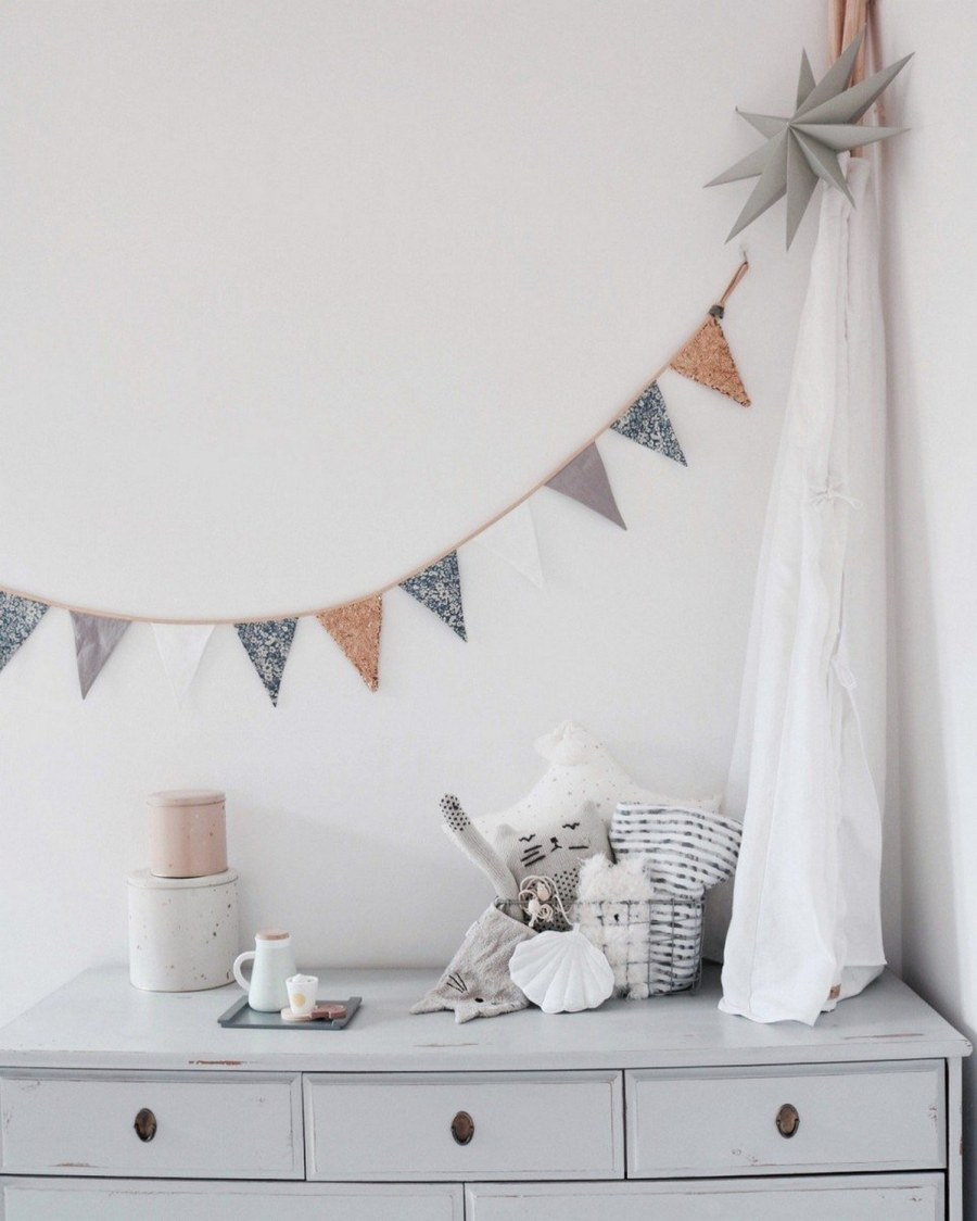 Garlands come in a variety of styles, colors, shapes and sizes, and with their curved lines, they work perfectly as decor for either a boy's or a girl's space.