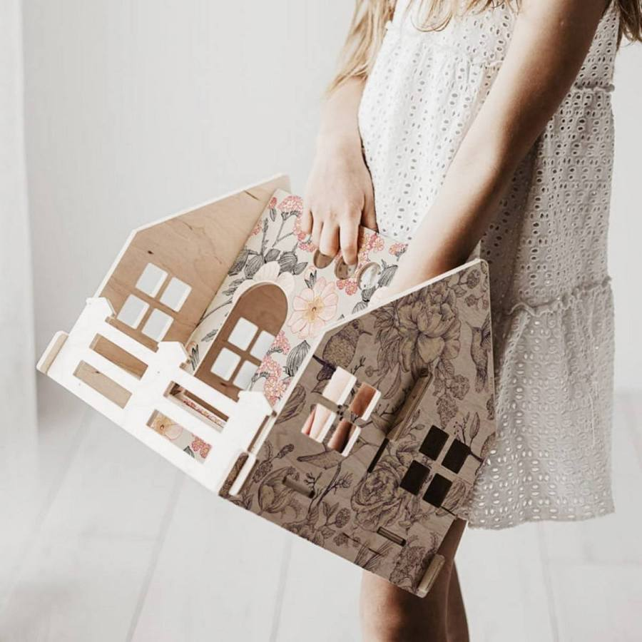 A wooden dolls house is the perfect way to spark your child's imagination. Traditional dollhouses can be an amazing gift for the child in your life.