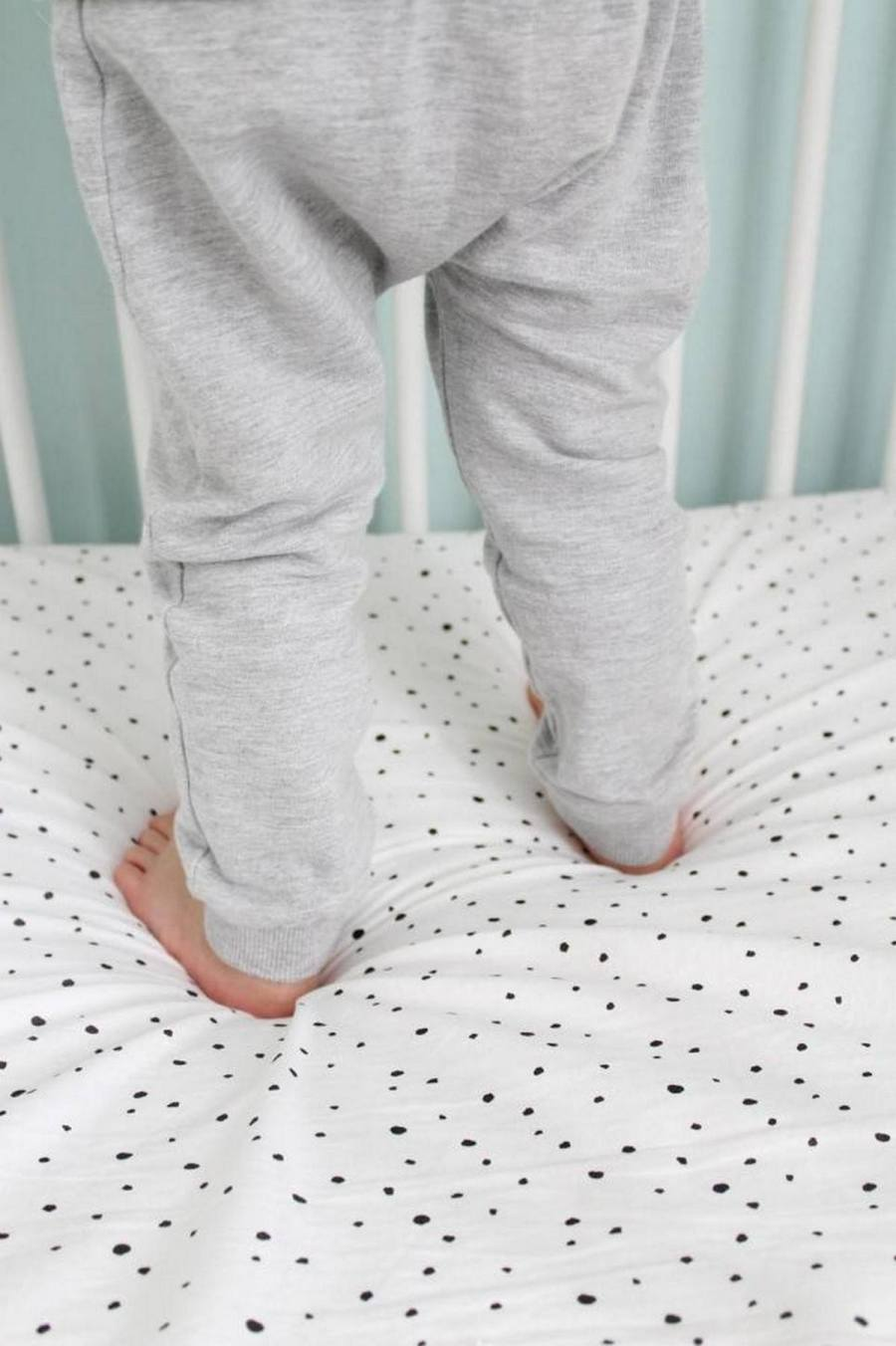A cot sheet is bigger than a baby crib sheet, since this sheet has to fit in a cot bed. A cot sheet is 150x120 cm and is combined with a cot blanket: the sheet goes underneath and the blanket goes on top. Then the sheet is folded.