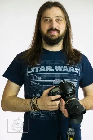 Photographer Andrew Bert Greaves holding a camera