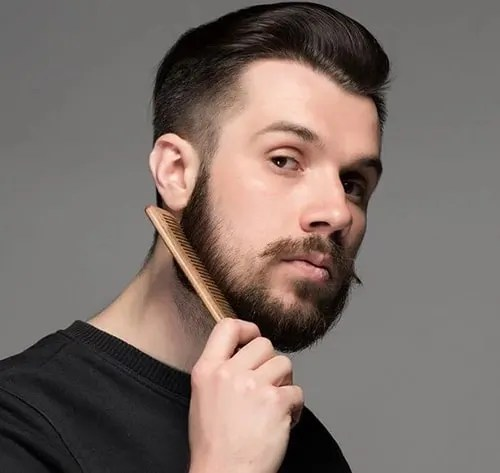 Full Beard with a Cheek Pointed Mustache Style