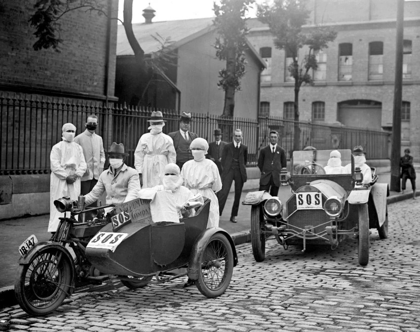 Medical staff in a car and motorcycle sidecar during the Spanish Flu pandemic in 1918