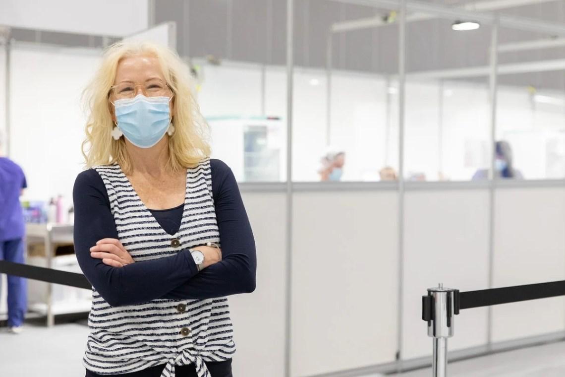 Professor Tina Brock, wearing a mask, at Royal Melbourne Hospital's vaccination hub