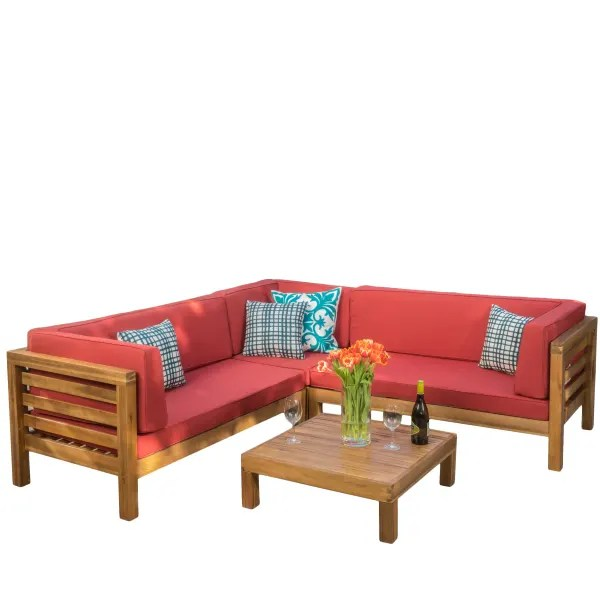 4 piece outdoor sectional set with red cushions