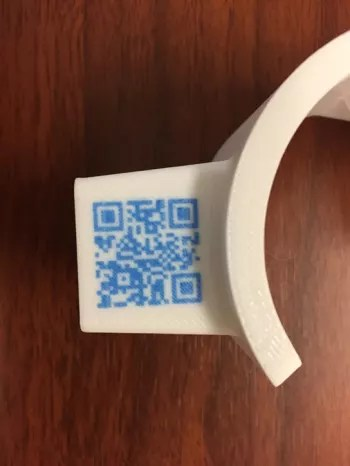 A part 3D printed with APD featuring an embedded QR code. (Image courtesy of Rize.)