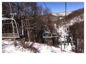 Snowboarders riding the ski lift at Wolf Ridge Ski Resort, NC