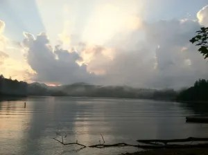 Sunlight throught clouds over Lake Glenville NC