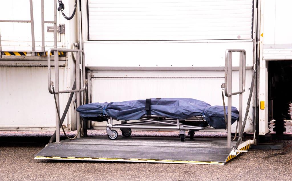 A mortuary stretcher left sat outside a mobile mortuary.