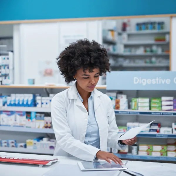 Pharmacist working on tablet
