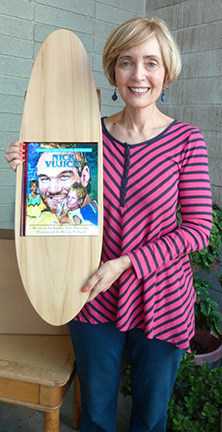 Renee skateboard with Nick Vujicic book front