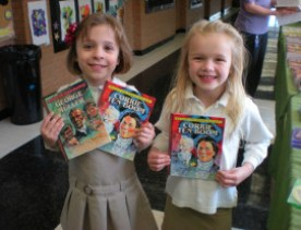 2 smiling girls holding Renee Taft Meloche's books