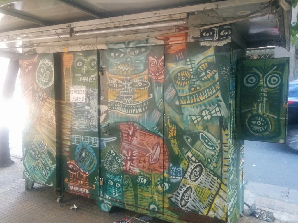 graffiti covered kiosk