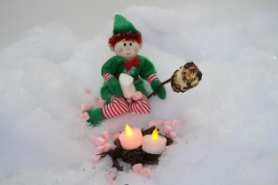 An elf roasting a marshmallow