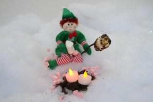 An elf roasting a marshmallow