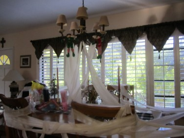 Oh no, the elves rolled the dining room with toilet paper