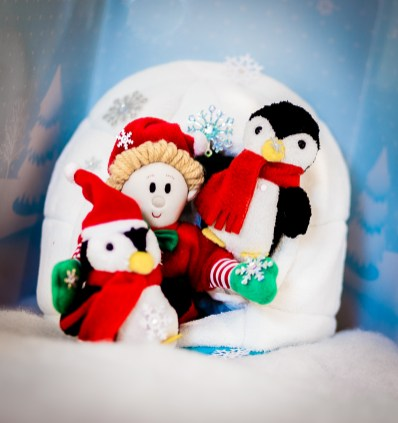 An elf with his pet penguins