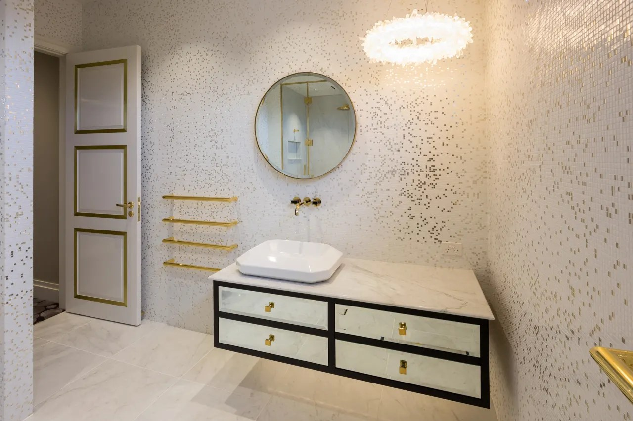 gold accents mirror front drawers and