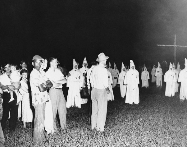 A lone African-American man attends a Klan rally in Jackson, 1950.