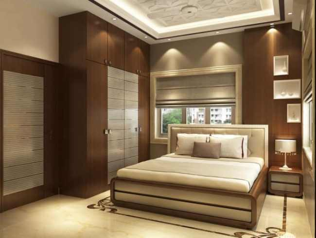Modern bedroom with wooden designed wall and wardrobe by ...