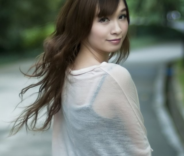 A Beautiful Chinese Girl Posing Outdoors Free Stock Photo