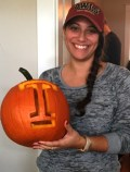 Pumpkin carved with her college logo. (Not a costume)
