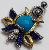 Prototype version of the Zen Garden enhancer. This one has sapphires and diamonds and a faceted turquoise focal stone.