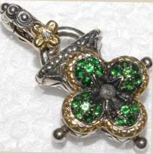 Tsavorite pave lotus-shaped lock. Rare.