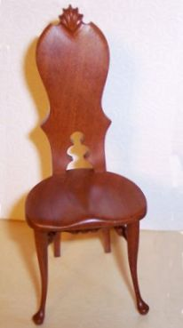 Joe Ryan made this unusual side chair that kind of evokes a donut-hole version of a Queen Anne chair. I love its quirkiness.