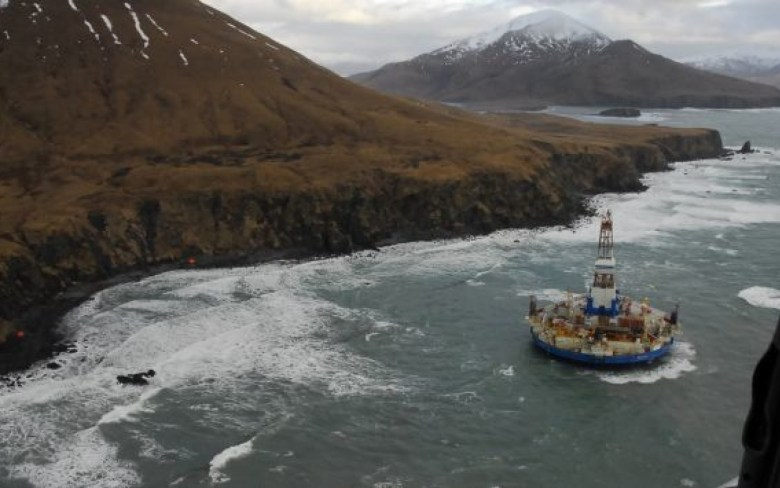 The conical drilling unit Kulluk sits grounded 40 miles (64 kms) southwest of Kodiak City, Alaska in this U.S. Coast Guard handout photo taken January 3, 2012. Kulluk, a Shell oil drilling rig grounded off an Alaska island since a New Years Eve storm, has suffered damage from waves and flooding but has spilled none of the 155,000 gallons of fuel and other oil products aboard, officials managing the incident said on Thursday. REUTERS/U.S. Coast Guard/Petty Officer 2nd Class Zachary Painter/Handout (UNITED STATES - Tags: DISASTER ENVIRONMENT) THIS IMAGE HAS BEEN SUPPLIED BY A THIRD PARTY. IT IS DISTRIBUTED, EXACTLY AS RECEIVED BY REUTERS, AS A SERVICE TO CLIENTS. FOR EDITORIAL USE ONLY. NOT FOR SALE FOR MARKETING OR ADVERTISING CAMPAIGNS