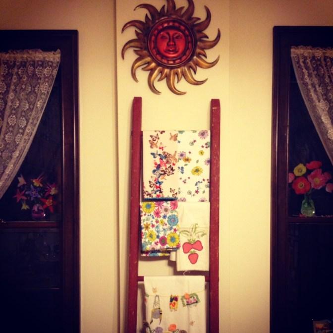 Teatowel collection displayed on Clyfford Stills ladder