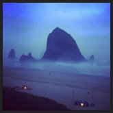 Haystack Rock shrouded in fog