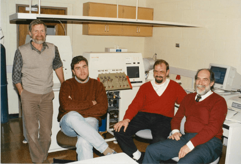 Installation of the MAT252 at Aspendale in August, 1990. From left: Roger Francey, Colin Allison, and Finnigan MAT representatives Winfried Schmidt and Jim Bearpark