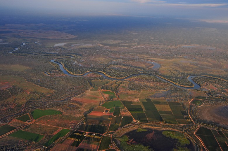River winding through crop lands